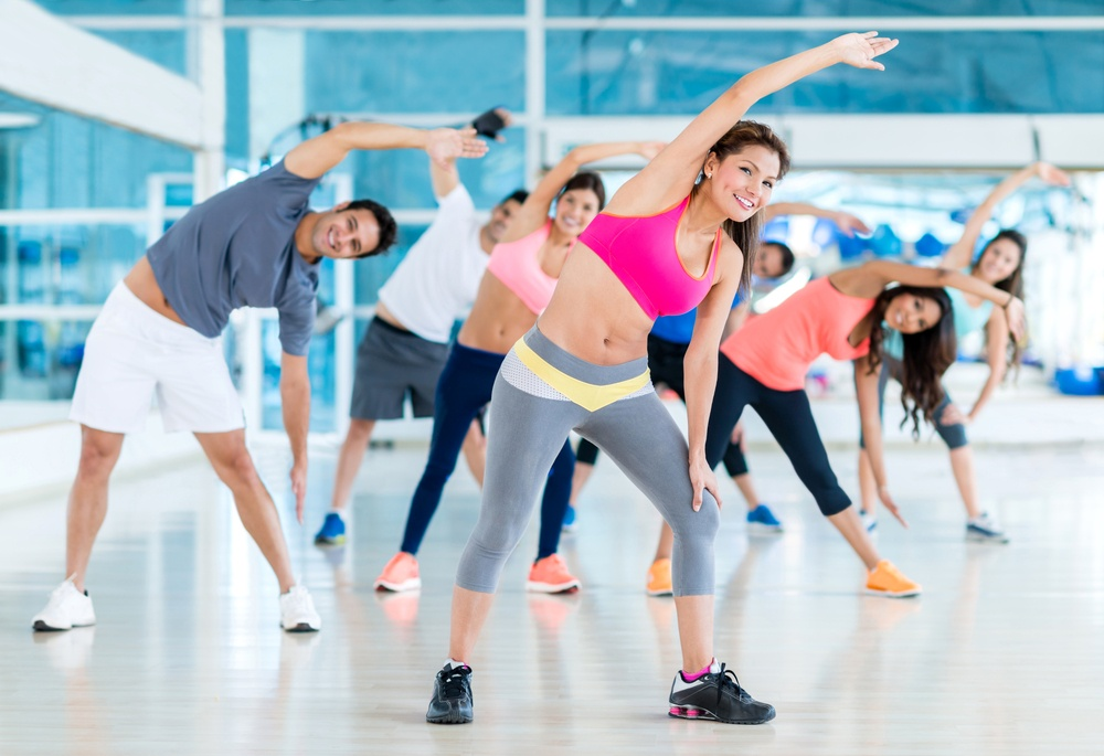 Group of gym people in a stretching class .jpeg